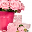 Bouquet of pink roses and gifts isolated on white — Stock Photo