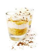 Banana dessert with whipped cream — Stock Photo