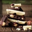 White and dark chocolate with nuts — Stock Photo