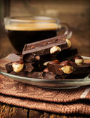 Black chocolate with nuts — Stock Photo