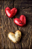 Decorative red and gold hearts — Stock Photo