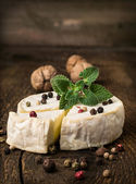 Brie cheese with spices and mint  — ストック写真
