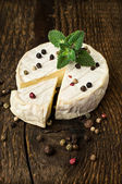 Brie cheese with spices and mint  — Stock Photo
