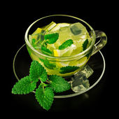 Lemonade with ice and mint in a glass cup  — Foto de Stock