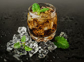 Whiskey with ice and mint  — Stock Photo