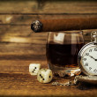 Still life with cognac, cigar , dice and a watch — Stock Photo #48123443