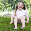 Young girl laughing in the grass — Stock Photo