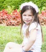 Little girl with a birthday crown in the garden — Stock Photo