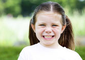 Young girl laughing in the park — Stock Photo