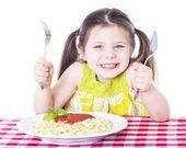 Beautiful girl eating pasta — Stock Photo