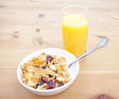 Breakfast cereal with juice — Stock Photo