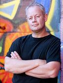 Man with urban graffiti background — Stock Photo