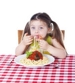 Girl shoving pasta in her mouth — Stock Photo