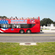 Tourist bus and WWII memorial — Stock Photo