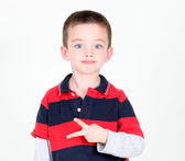 Young preschooler kneeling on white background — Stock Photo