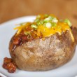 Loaded baked potato with chili and cheese — Stock Photo #26339381