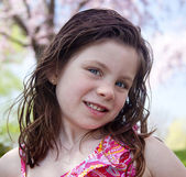 Happy little girl in a park — Stock Photo