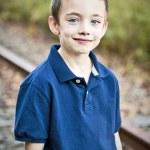 Handsome smiling boy outdoor portrait — Stock Photo