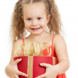 Happy child girl holding gift box — Stock Photo