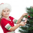 Pretty preschool child decorating Christmas tree isolated on whi — Stock Photo