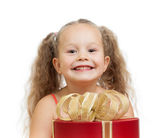 Happy child girl behind gift box — Stock Photo