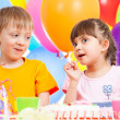 Birthday of cute kids twins — Stock Photo