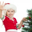 Pretty preschool child decorating Christmas tree isolated on whi — Stock Photo #12606240