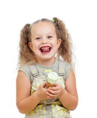 Little curly girl eating ice cream in studio isolated — Stock Photo