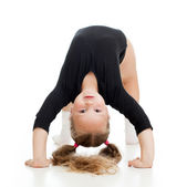 Young girl doing gymnastics over white background — Stockfoto
