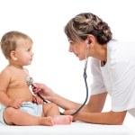Smiling doctor examining baby isolated on white background — Stock Photo