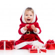 Santa Claus baby girl with gift box isolated on white background — Stock Photo