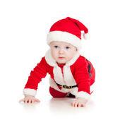 Baby toddler dressed as Santa Claus over white — Stock Photo