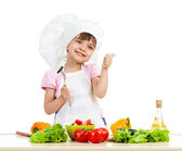 Chef girl preparing healthy food over white background — Stock Photo