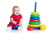 Baby girl playing with big toy isolated on white background — Stock Photo