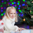 Happy child girl with book over  bright festive background — Stock fotografie