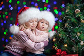 Funny baby in Santa Claus hat on bright festive background — Foto de Stock