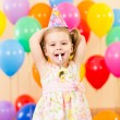 Pretty joyful kid girl on birthday party — ストック写真