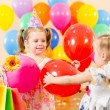 Foto Stock: Pretty children with colorful balloons and gifts on birthday par