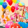 Happy children and clown on birthday party — Stock Photo