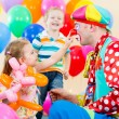 Foto Stock: Happy children and clown on birthday party