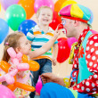 Happy children and clown on birthday party — Stockfoto #13358478