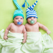 Two twins brothers babies weared in hats — Stock Photo