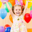 Pretty joyful kid girl on birthday party - Stock Photo