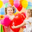 Pretty children with colorful balloons and gifts on birthday par — Stock fotografie