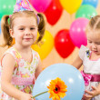 Pretty children with colorful balloons and gifts on birthday par — Stock Photo