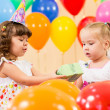 Pretty children with colorful balloons and gifts on birthday par — Stock Photo #13466920
