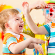 Joyful kids with clown on birthday party — Stock Photo