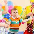 Joyful kids with clown on birthday party — Stockfoto