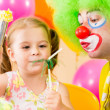 Happy child girl with clown on birthday party — Stock Photo #13468478