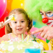 Happy child girl with clown on birthday party — Stock Photo #13468797